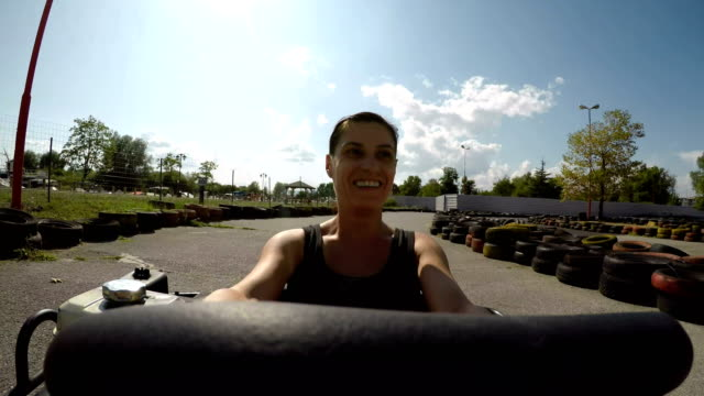 I am young too! 40 years old woman on go-carting race.point of view