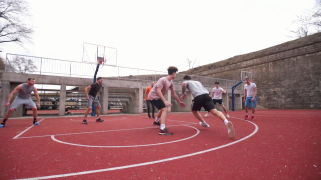Amateur basketball match between friends Group of young adults playing amateur basketball outdoor practice drill stock videos & royalty-free footage