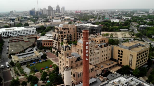 Amazing Aerial Shot Circling the Pearl Pride Tower in the San Antonio, Texas Pearl District 4k drone shot circling around the Pearl Districts Pride Brewing Company Tower in San Antonio, Texas south stock videos & royalty-free footage