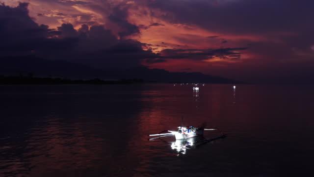 Amazing Aerial Shot Of Inle Lake Fishermen. Inle Lake Fishermen Fishing On Traditional Net And Boat At Sunset. Aerial Famous Tourist Travel Destination. Bali, Indonesia
