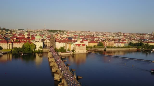 Amazing aerial view of the Prague city Charles bridge from above.