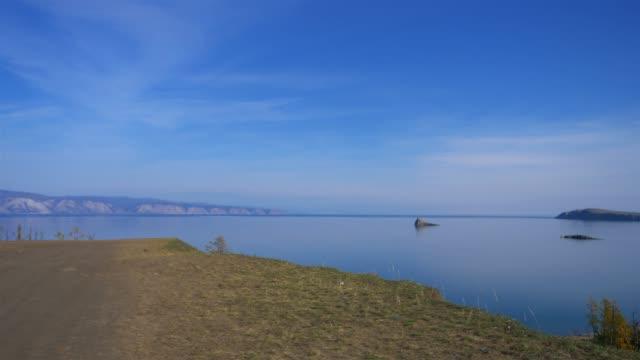 vídeos de stock e filmes b-roll de amazing beautiful landscape of baikal lake blue sky clean water in olkhon island, irkutsk russia - irkutsk