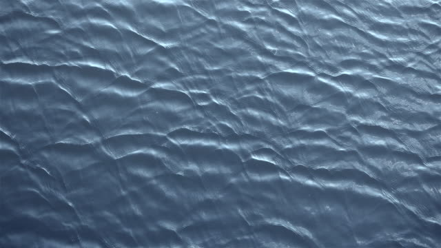 Amazing closeup nature texture of running ripple on the water. Cinematic moving background with meditative and hypnotic effect. video