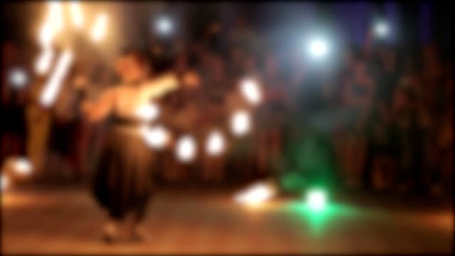 amazing fireshow by young woman and man on a street. blurred frame for abstract background. - circus стоковые видео и кадры b-roll