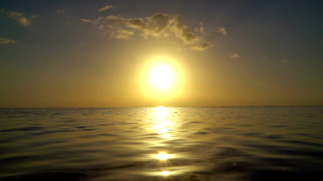 SLOW MOTION: Amazing golden sunset over the calm ocean video