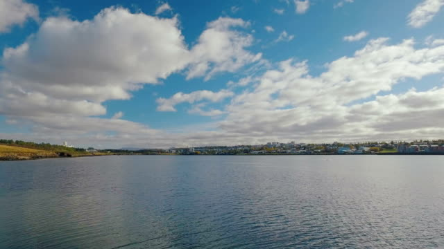 amazing landscape with cloudy sky and panorama of Reykjavik city in sunny calm weather video