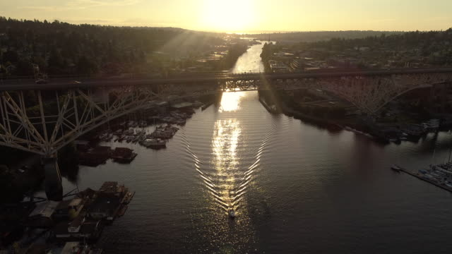 Amazing Lighting Aerial of Big City Bridge and Boat Cruising in Canal video