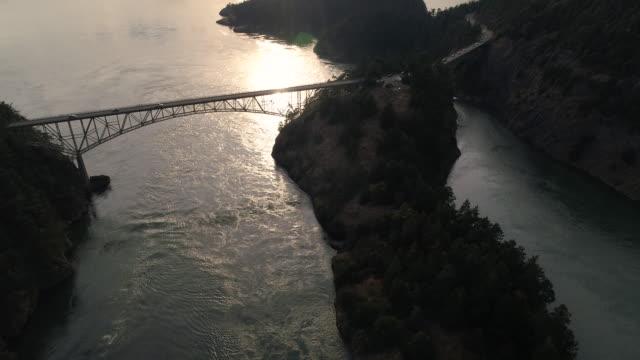 Amazing Lighting in Aerial of Bridge Crossing Ocean Islands in Pacific Northwest video