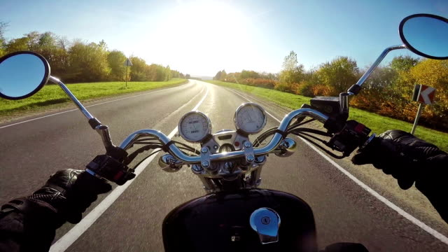 Amazing motorcycle riding towards sun in evening. Classic cruiser/chopper forever! Amazing motorcycle riding towards sun in evening. Classic cruiser/chopper forever! motorcycle stock videos & royalty-free footage