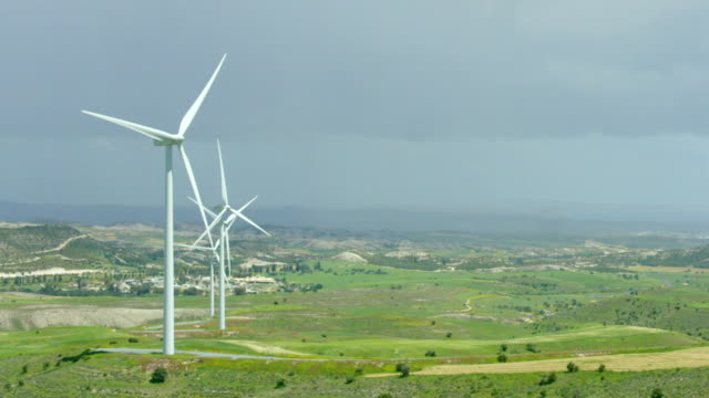 Amazing panorama of beautiful landscape, wind turbines rotating, green hills video