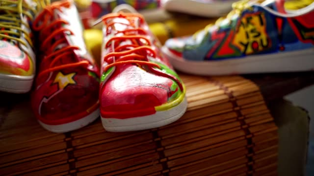 Amazing pieces of abstract arts in a artist workshop Ehibition of few pairs of sneakers at the artist workshop painting art product stock videos & royalty-free footage