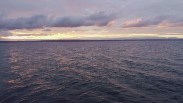 amazing purple colored sea sunset orange clouds light rays - ocean spokojny filmów i materiałów b-roll