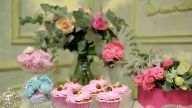 Amazing raspberry cake and flower bouquete decoration of the table. vintage video