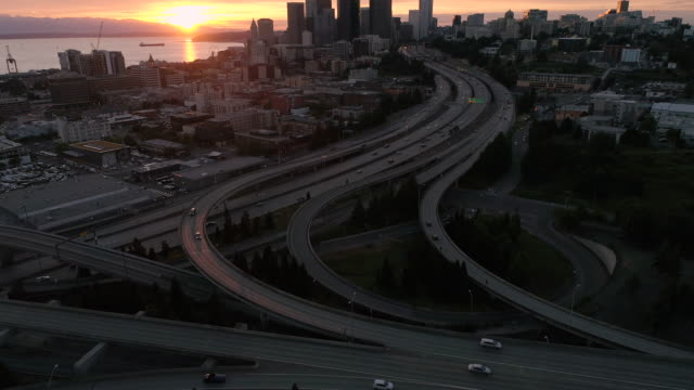Amazing Sunset Aerial of Seattle, Washington with Vibrant Orange Glow on Skyscraper Buildings in City Skyline video