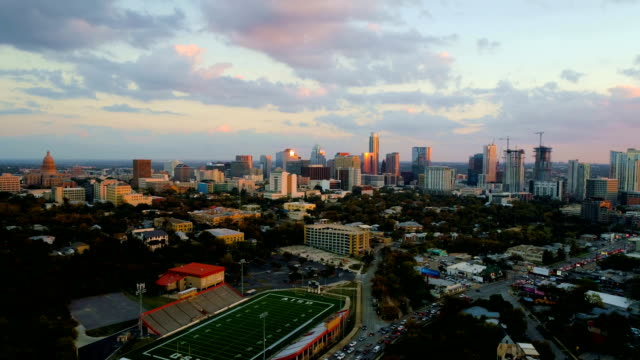 Amazing Sunset flying over Iconic Area of Austin on Lamar Street with perfect sunset hitting the Skyline of Austin , Texas video