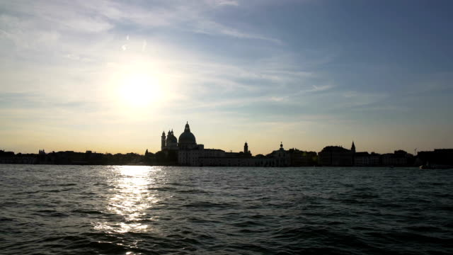 Amazing sunset in Venice, boat cruise on Grand Canal, sightseeing, tourism video