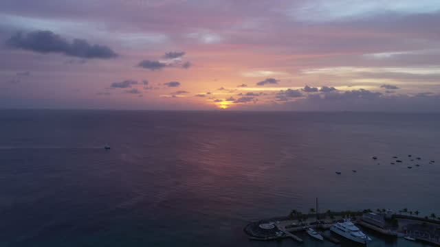 Amazing sunset over tropical seafront community (2) video
