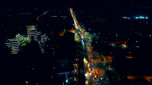 Amazing time lapse aerial drone shot of city central district at night video
