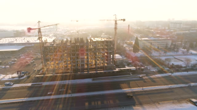 Amazing timelapse shot of a drone rotating around a counstruction site at sunset video
