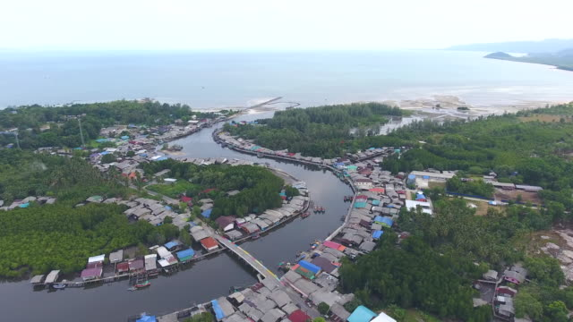 amazing view of coastal village with curved river and sea background, aerial video - графство дерри стоковые видео и кадры b-roll