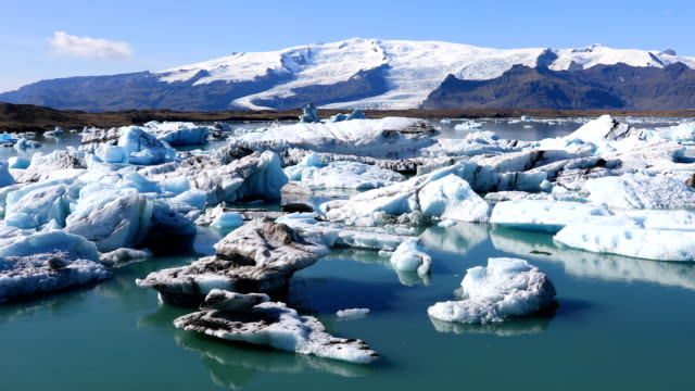 Amazing view of glacial lake Jokulsarlon in Iceland Amazing view of floating icebergs in the glacial lake Jokulsarlon on the background of blue sky, Iceland icecap stock videos & royalty-free footage