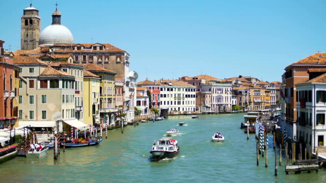 Amazing view of Grand Canal, water taxis and private boats sailing river, tour video