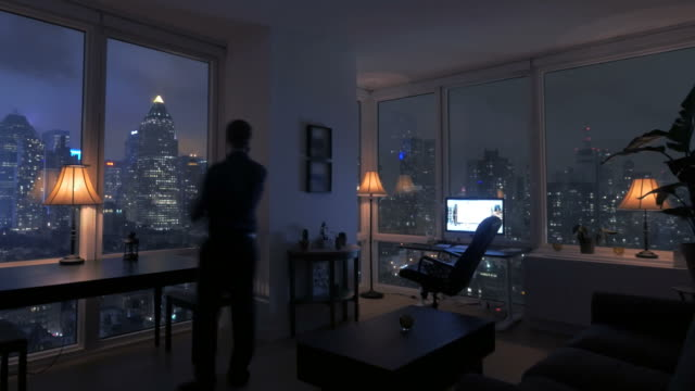Amazing View of High Rise Apartment Loft at Night. Urban City Lifestyle Background.