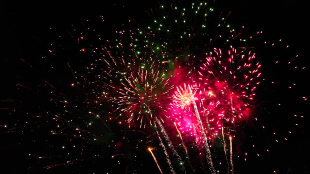 amazingly colorful and spectacular fireworks display, seamless loop - canada day stock videos & royalty-free footage