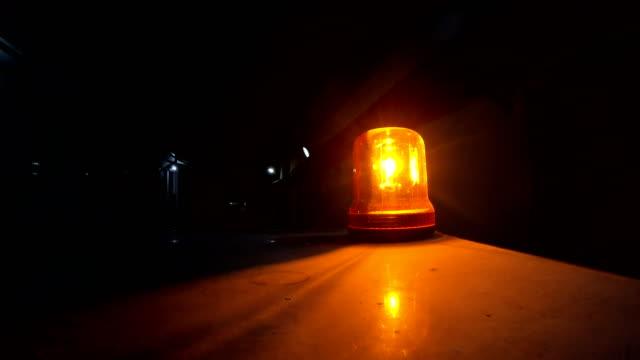 Amber Warning Signal Siren Light at top of fireman vehicle at night