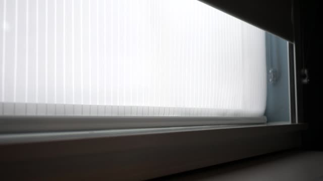 Ambient blinds open from modern interior window - ALT - vídeo