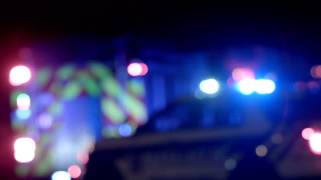 Ambulance, Cops and Firetrucks Blurry Lights Background at Night