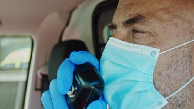 slo mo ambulance driver using the cb radio - paramedic stock videos & royalty-free footage
