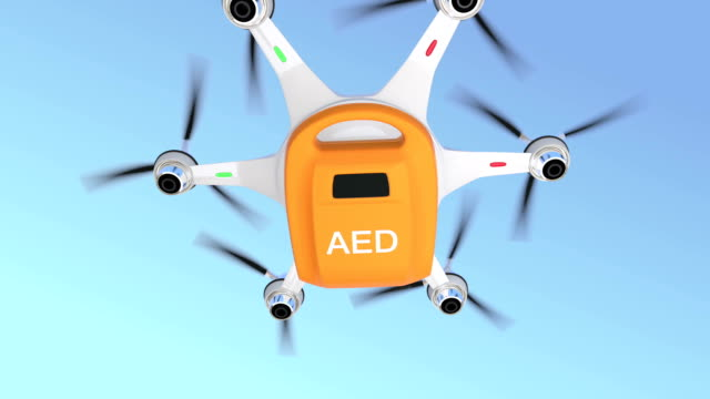 Ambulance drone delivers AED kit Ambulance drone delivers AED kit for emergency medical care concept. defibrillator stock videos & royalty-free footage