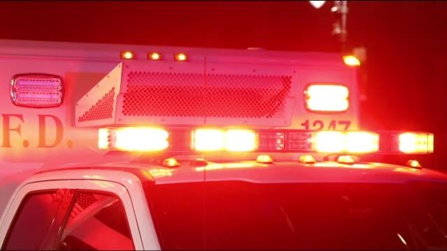ambulance lights flashing at night downtown - paramedic stock videos & royalty-free footage