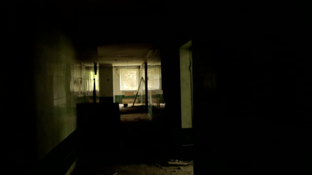 Сamera flying in the hallway of abandoned house. POV, steadycam video