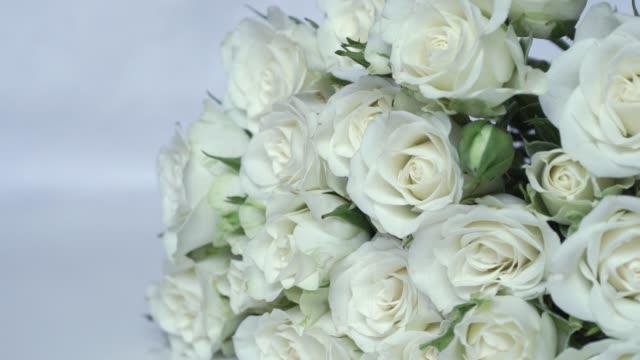 Сamera movement on beautiful bouquet white garden bush fresh roses.