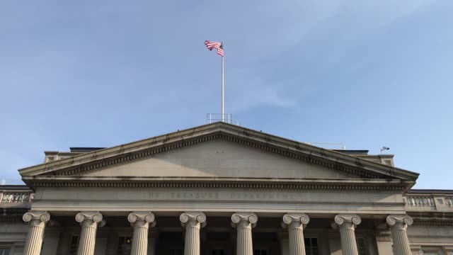 America / United States Department of the Treasury Pan Down. Washington DC USA,May 28 2019 :North side,United States Department of the Treasury,Building Exterior. Swinging down from the blue sky. treasury stock videos & royalty-free footage
