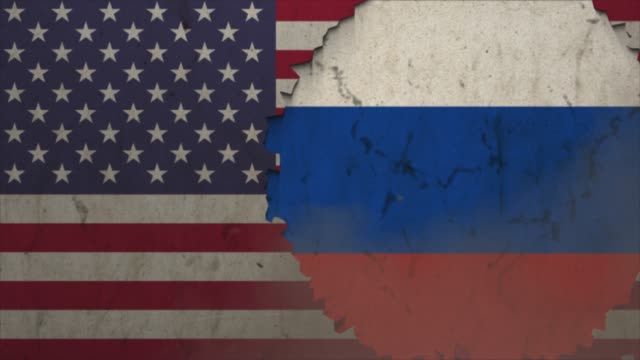 American and Russian flags on the stone wall stock video