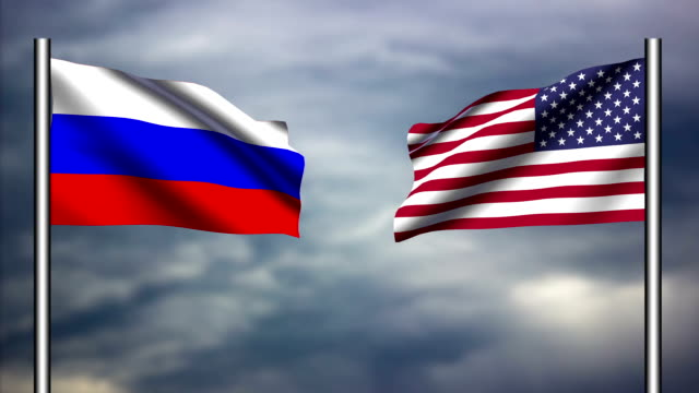 american and russian flags waving against each other - 俄羅斯 個影片檔及 b 捲影像