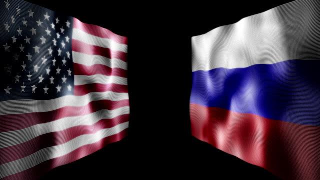 vídeos de stock, filmes e b-roll de agitando bandeiras americanas e rússia contra os outros - rússia