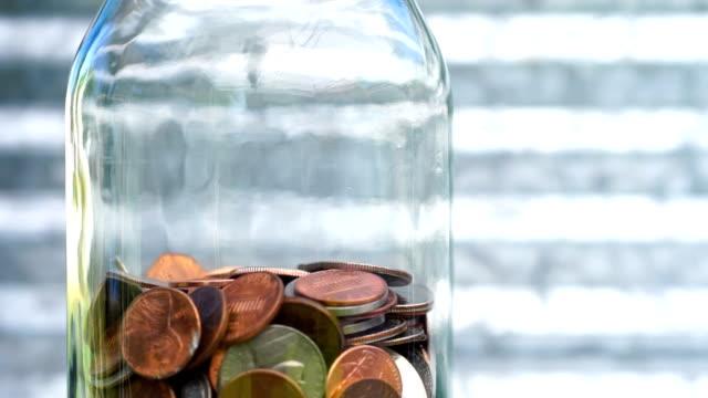 American Dollar Currency Coins in Jar Pennies Nickels Quarters Dimes video