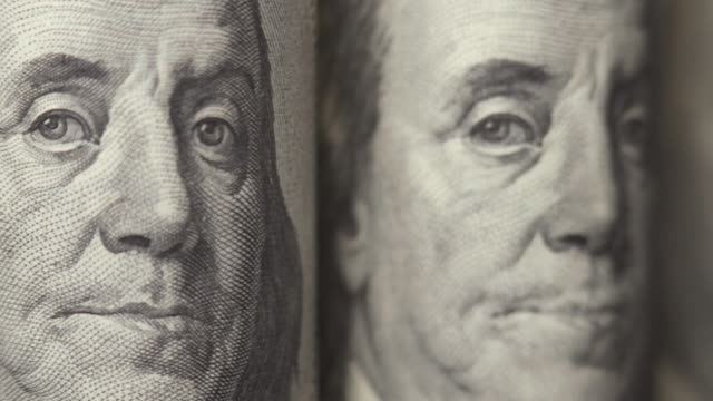 American dollars. Portraits of Franklin on one hundred dollar bills are moving in the frame. Cash. Money background. Close-up video