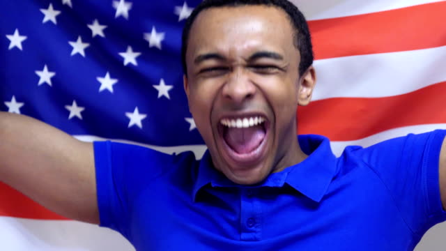 American Fan Celebrates holding the Flag of USA in Slow Motion