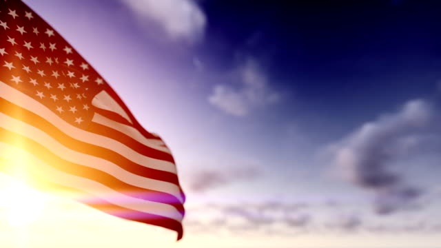 American Flag against Time Lapse Clouds video
