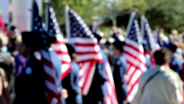 American Flag bearers in soft focus video