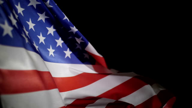 American flag blowing in the wind, slow motion American flag blowing in the wind, slow motion. independence day videos stock videos & royalty-free footage