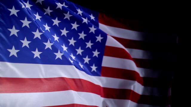 american flag blowing in the wind, slow motion - bandiera degli stati uniti video stock e b–roll