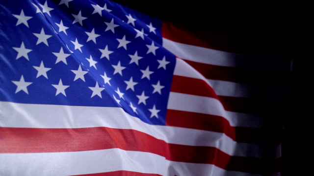 american flag blowing in the wind, slow motion - machać filmów i materiałów b-roll