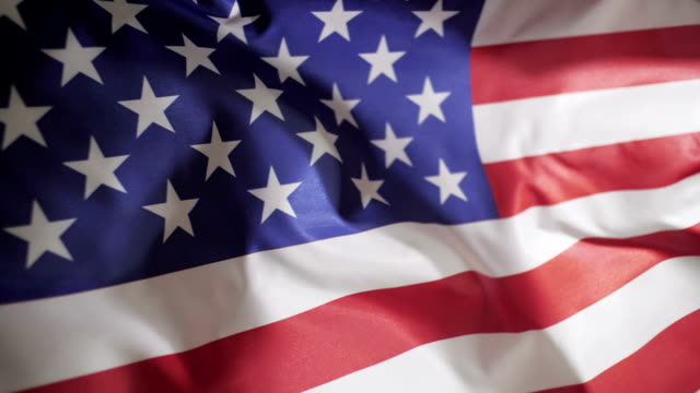 American flag blowing in the wind, slow motion video