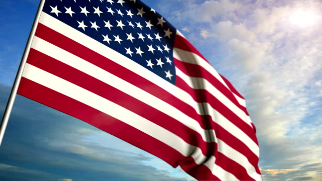 American flag floating on sunset sky background video